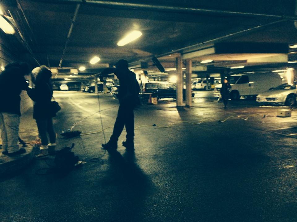 "On location in the underground parking garage of Tom Davies Square to film ""Stalking  by Numbers."""