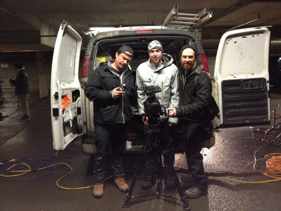 "FROM LEFT: The camera team - Gregory Tremblay (director of photography),  Eric Harrison (camera op), and Connor James (camera asst.) on the set of ""Stalking by Numbers""."