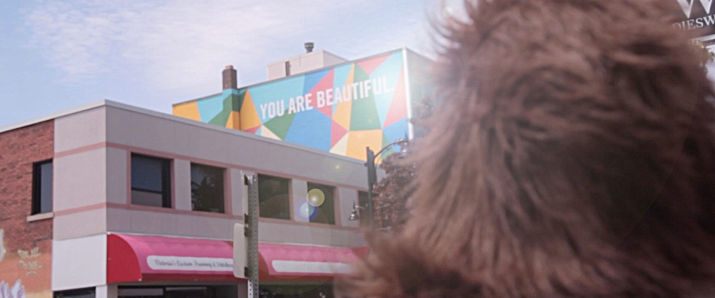 "The ""You Are Beautiful"" mural by We Live Up Here was the inspiration for ""Beautiful Monster""."